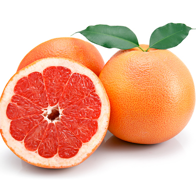 Grapefruit fruits with cuts and green leaf isolated