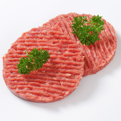 two raw hamburger patties with parsley on white background